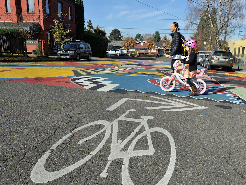 """Sharrows"" (bike lane markings with double arrow) connect low-traffic neighborhood greenway streets throughout the city, providing cyclists with safer options for getting around in Portland. Thursday, Nov. 10, 2016. (Greg Wahl-Stephens/AP Images for C40)"
