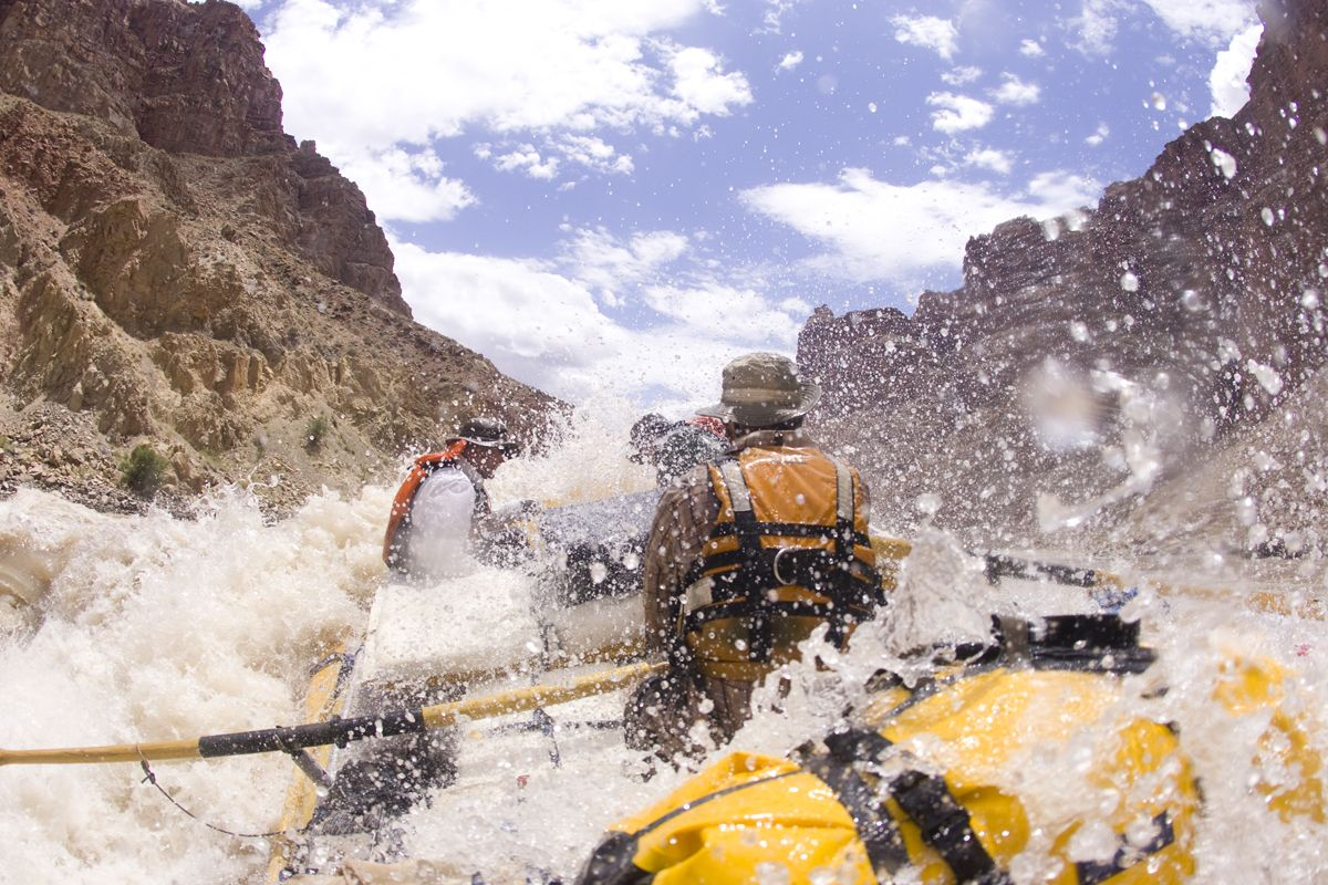 The Best National Parks for Rafting - Whitewater rafting in Cataract Canyon in Canyonlands National Park, UT.