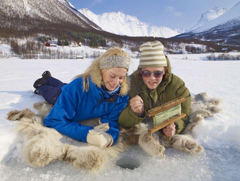 Ice fishing couple Norway