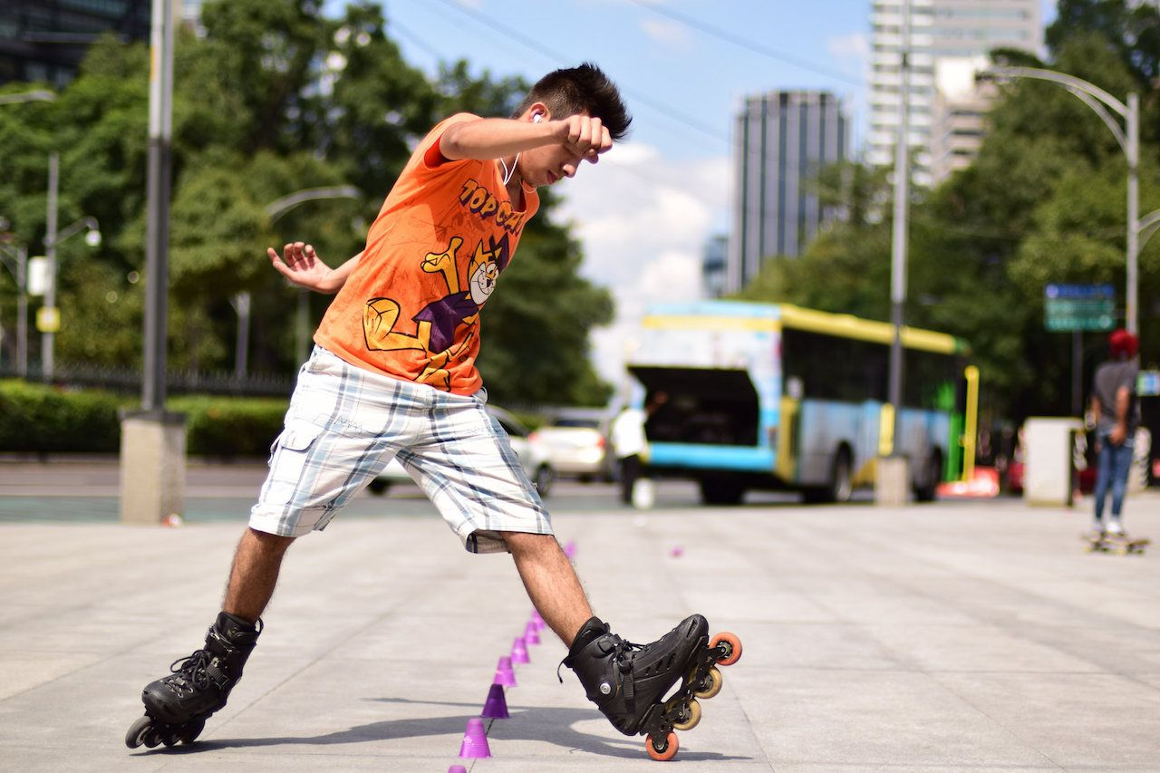 Mexico City with teenagers roller skating