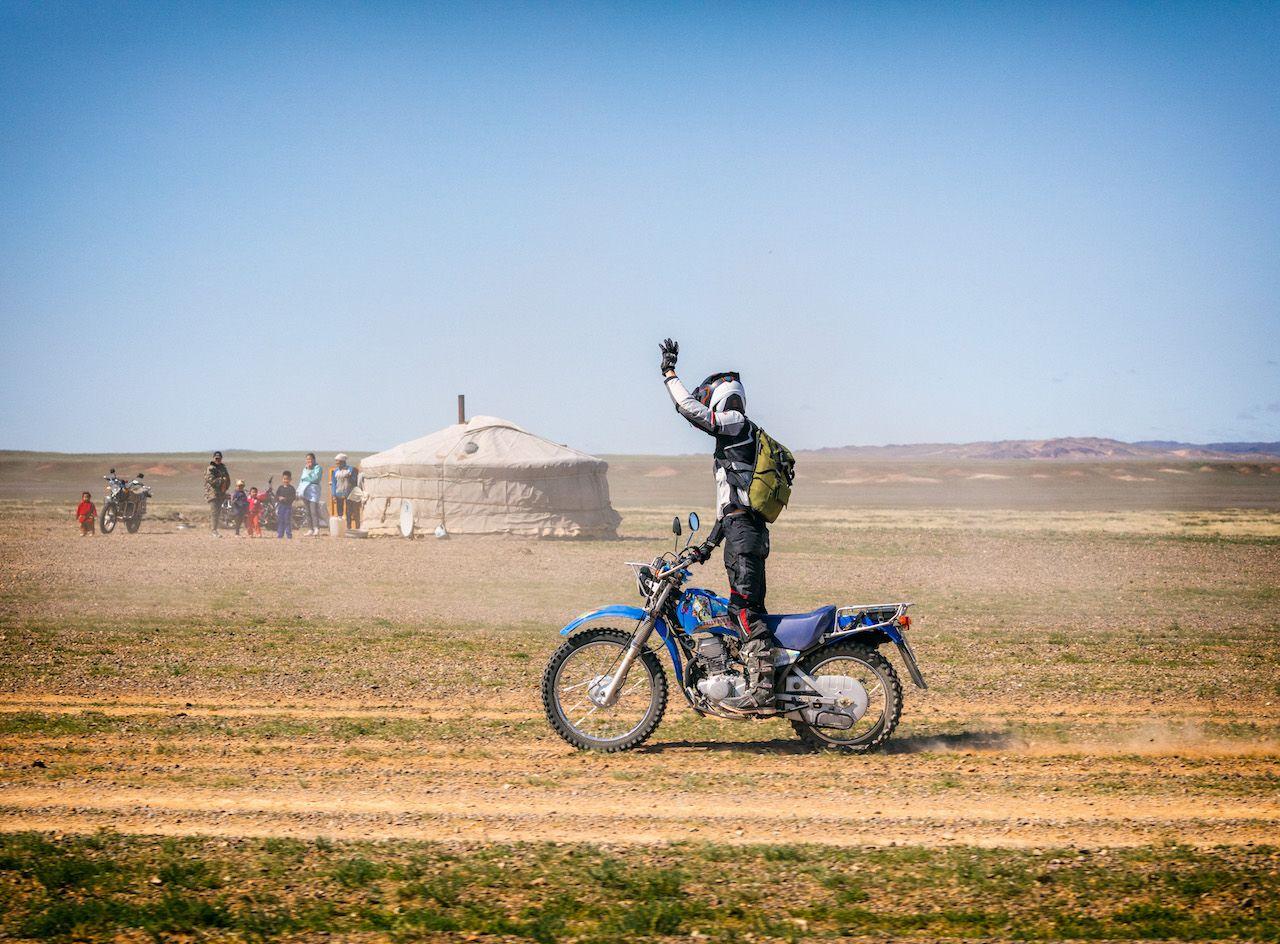 Mongolia_Motorcycle rider_waving