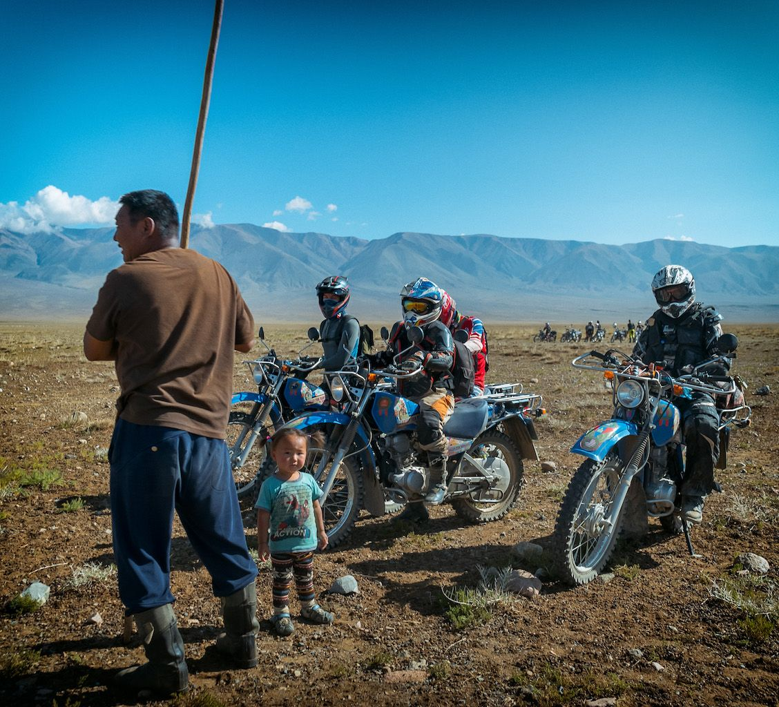 Motorcycle riders with Mongolian people