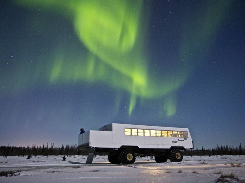 Northern lights over truck