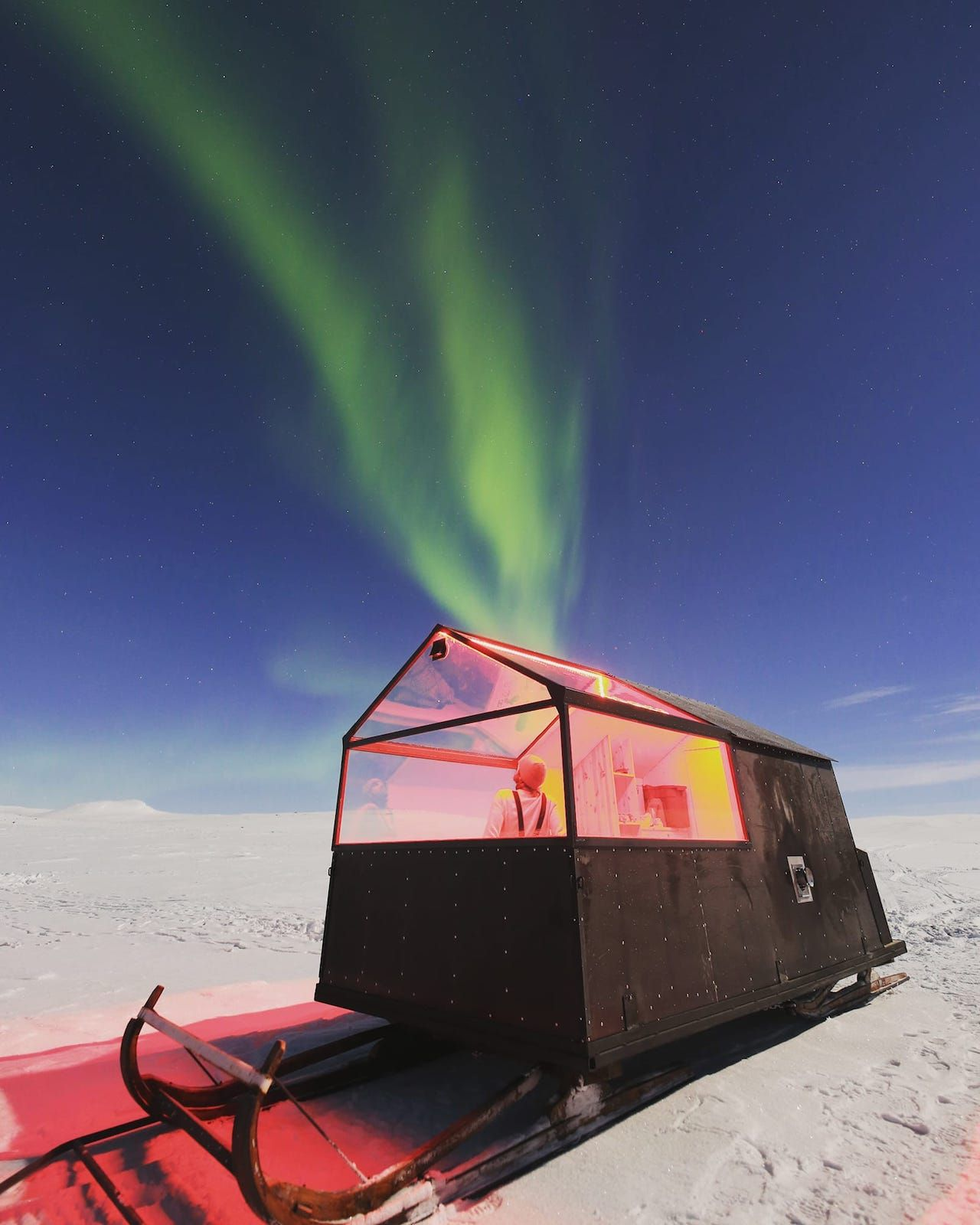 Northern lights above sled