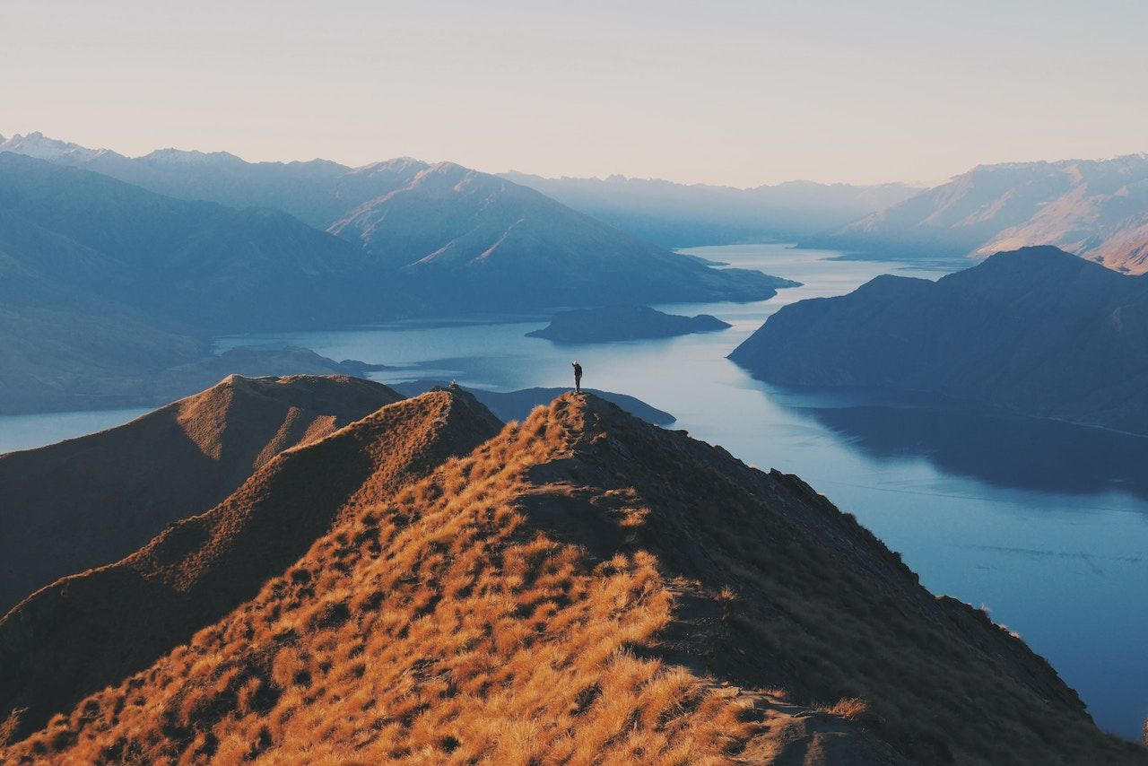 Person on hill in New Zealand