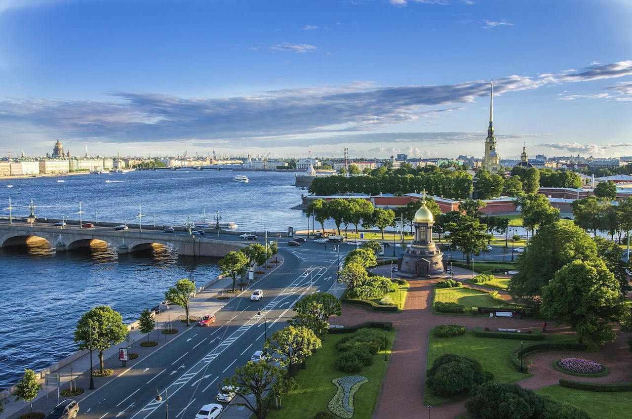 Panoramic view of Saint Petersburg with water and bridge, Russia from height. Summer sunset urban aerial view of St Petersburg landmarks