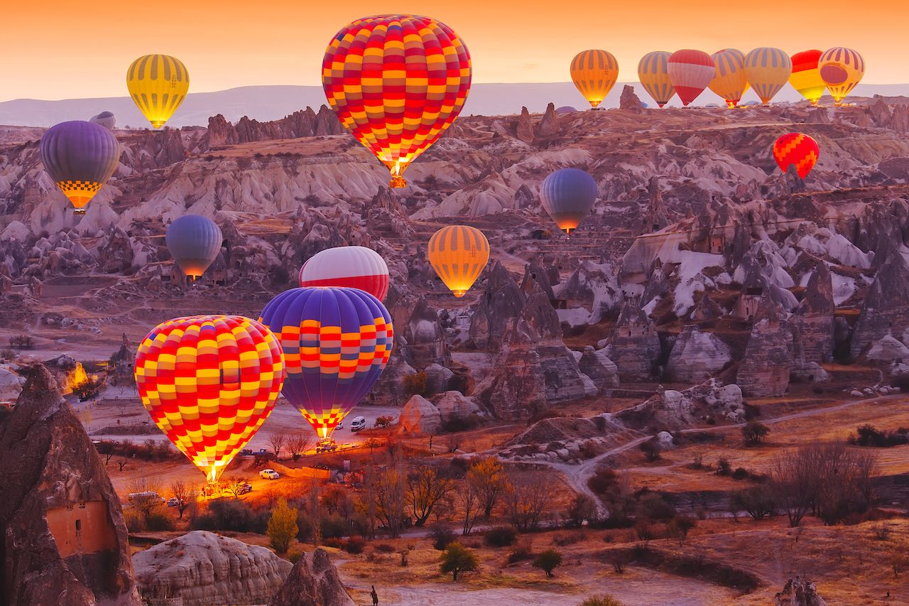 Beautiful vibrant colorful balloons in sunrise light in Cappadocia.