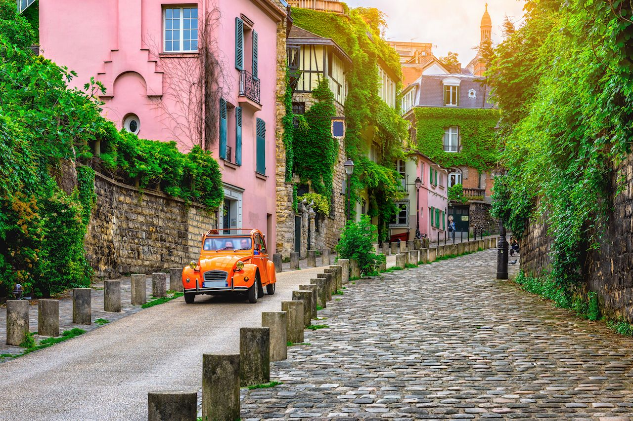 View of old street in quarter Montmartre in Paris, France. Cozy cityscape of Paris. Architecture and landmarks of Paris