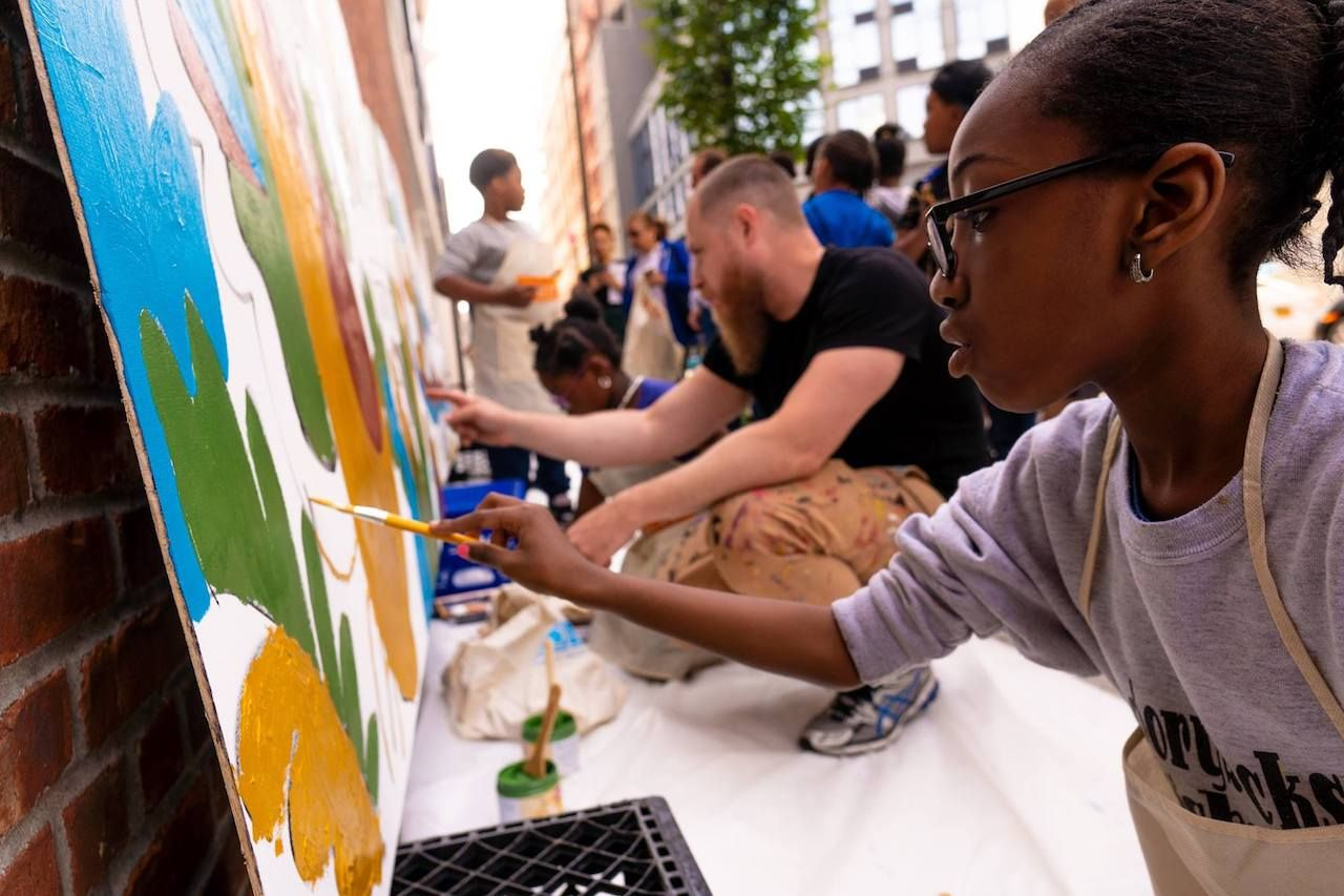 People painting at an art event in Brooklyn