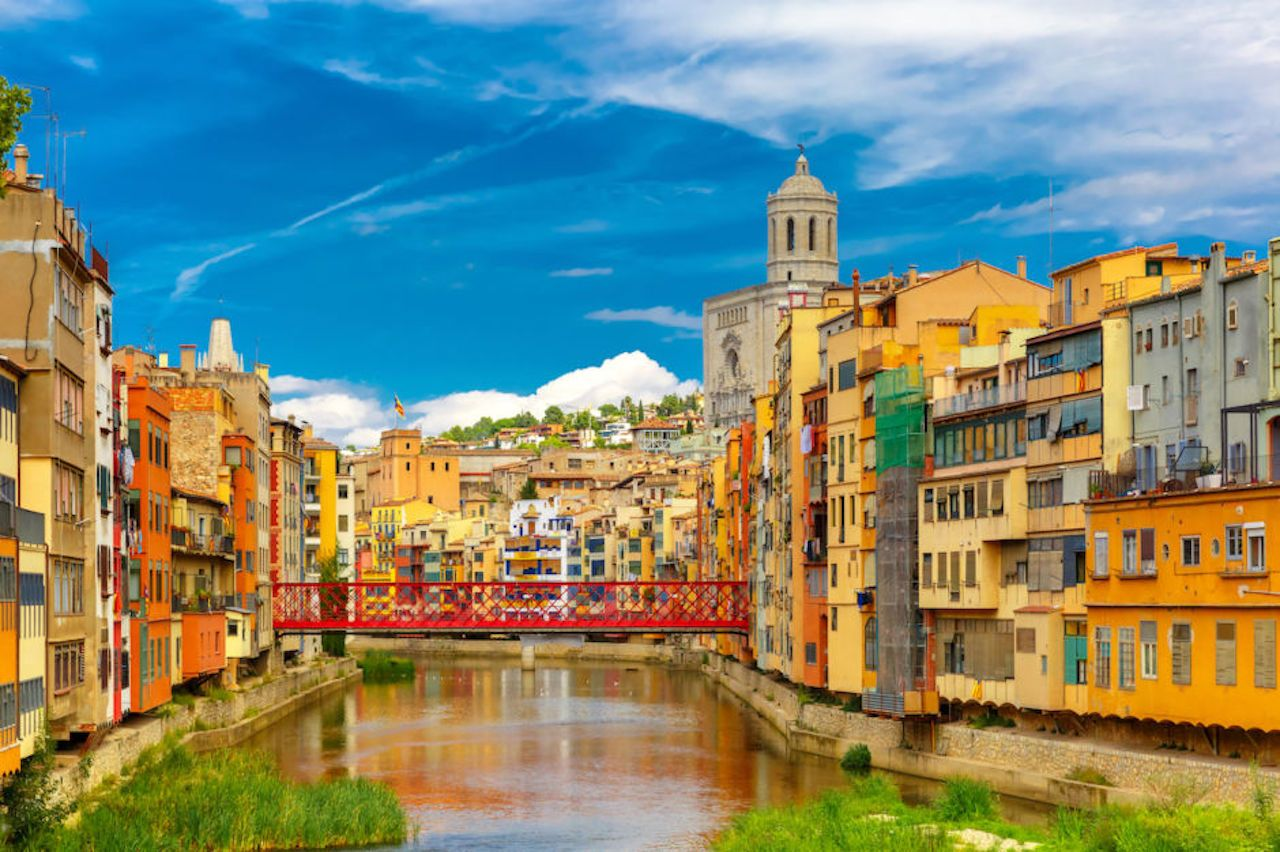 Colorful yellow and orange houses and Eiffel Bridge in Girona, Catalonia, Spain