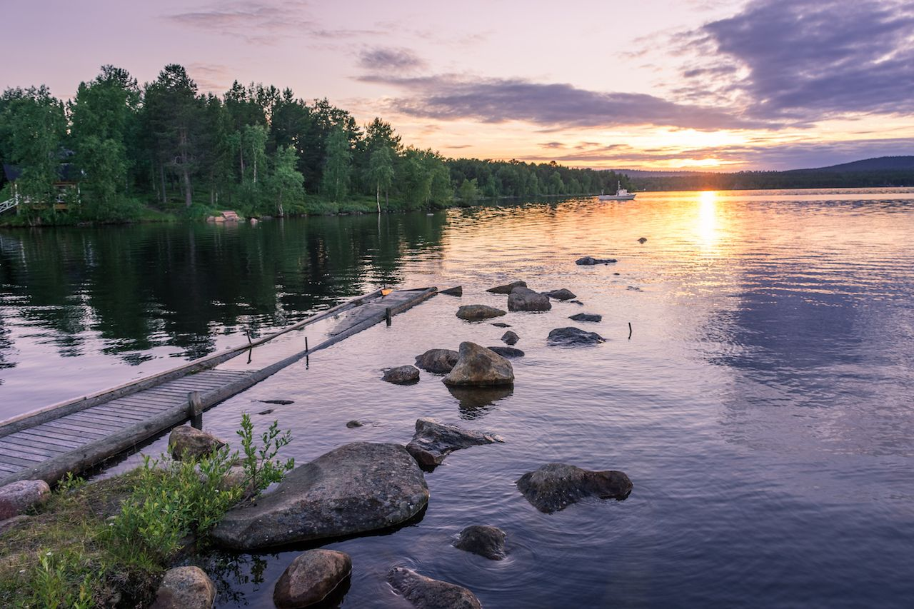 Pier, lake, midnight sun in Inari, Finland