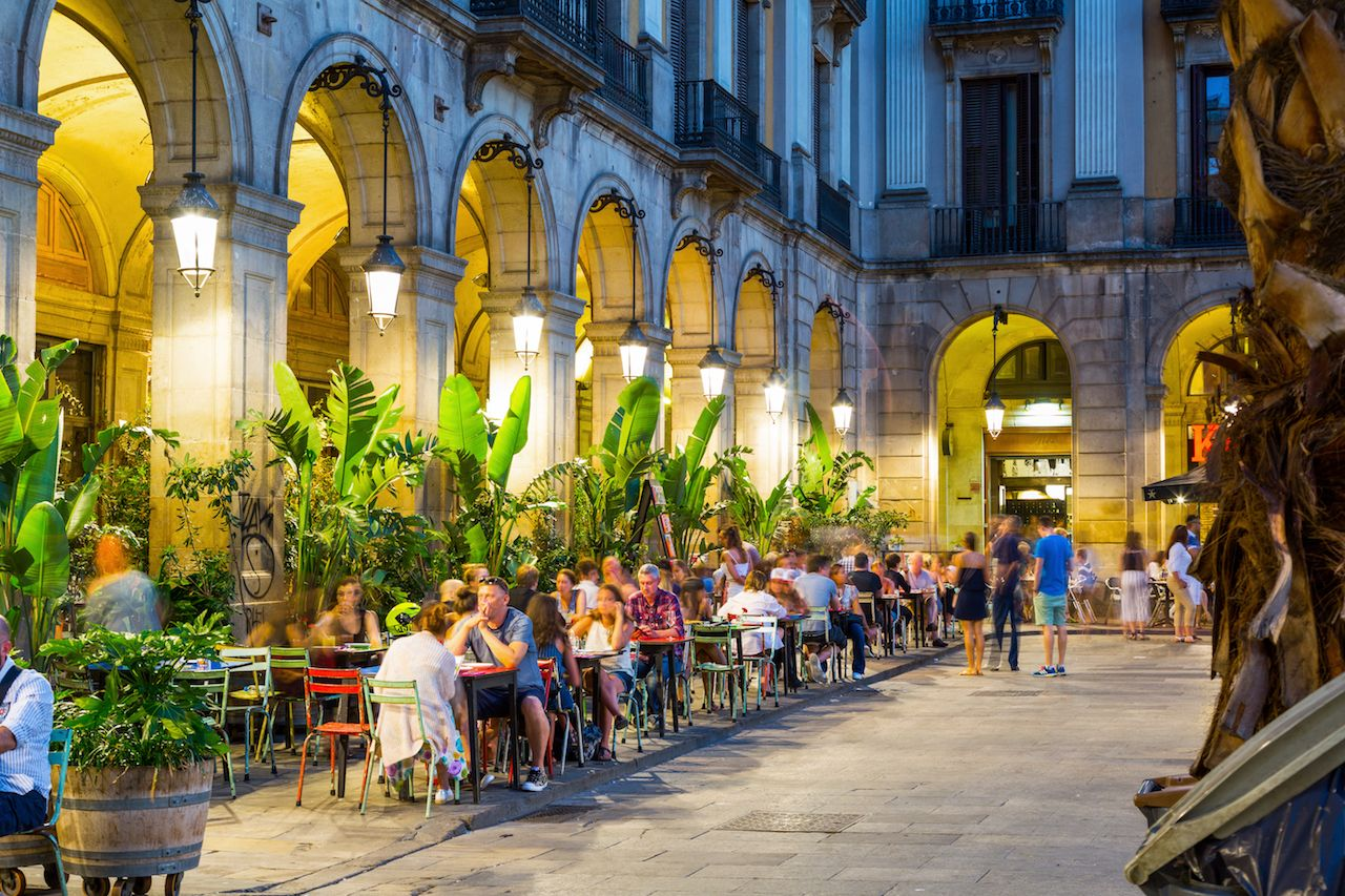 Royal Square with restaurants and other facilities illuminated at night in Barcelona