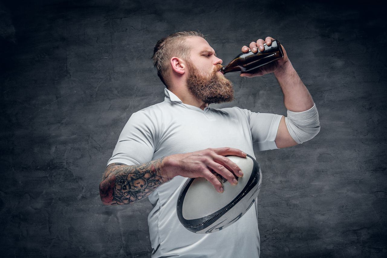 Rugby player drinking non-alcoholic beer