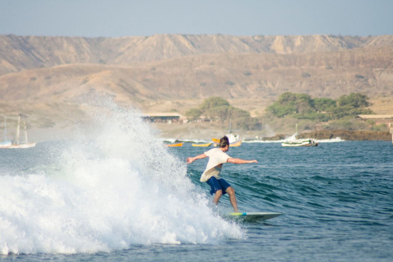 Riding a wave in Lobitos, Peru