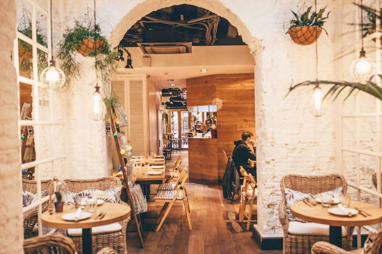 Cozy interior at Taberna Milgritos in Barcelona