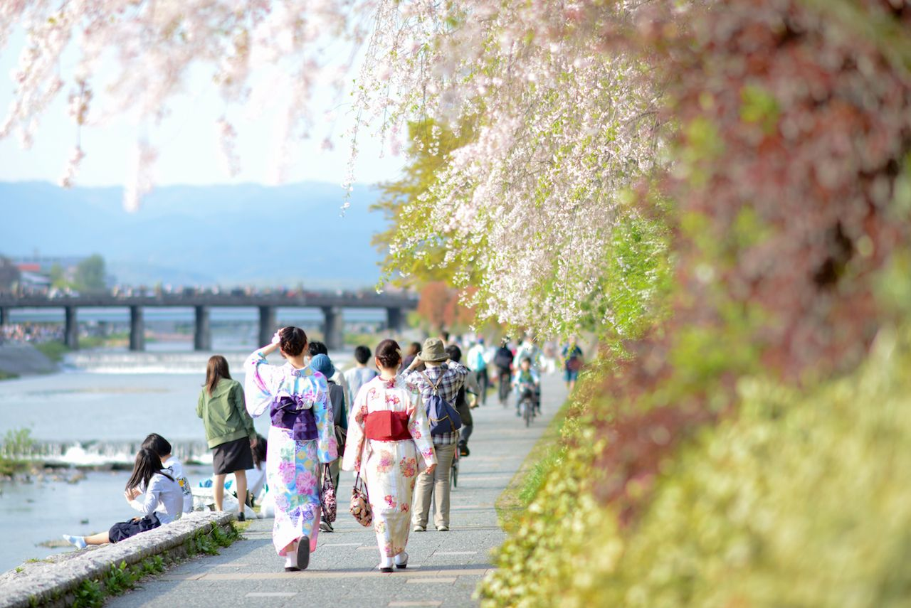 Kyoto bike-friendly waterways and women in traditional dress