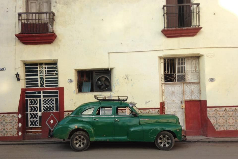 Old car against wall in Cuba