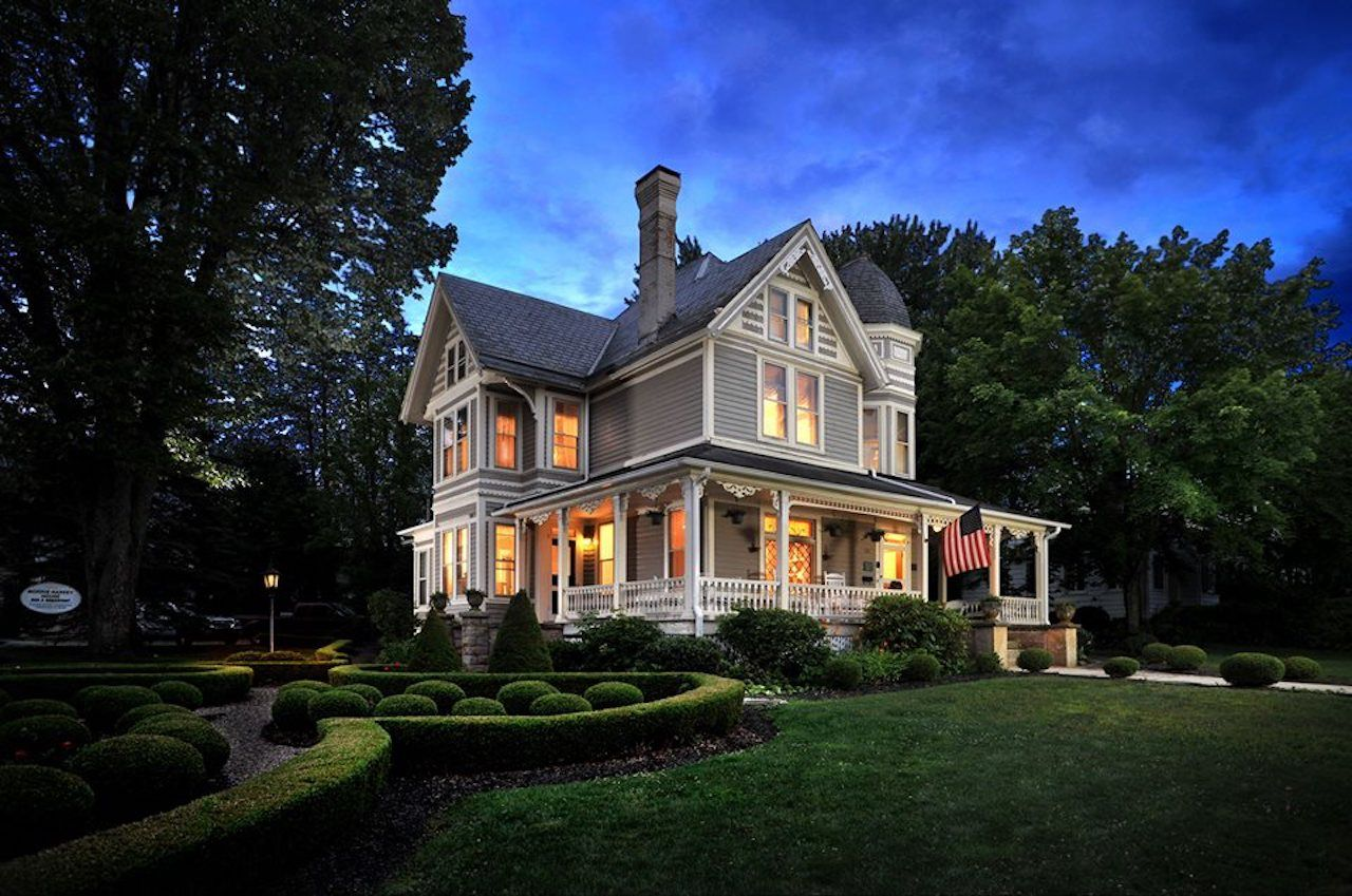 The elegant Historic Morris Harvey House Bed and Breakfast under dusky skies