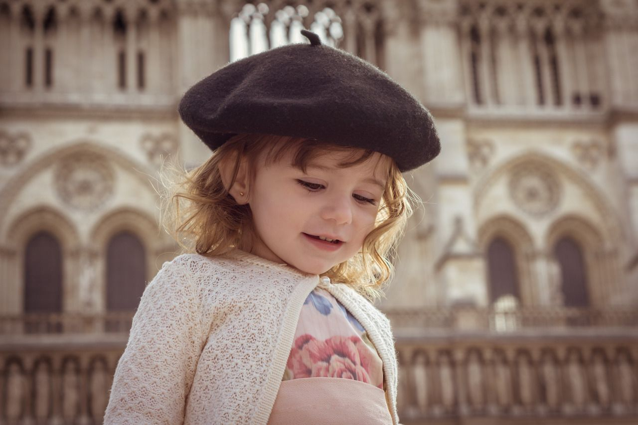Girl in a beret outside Notre Dame
