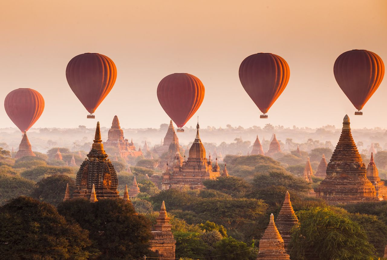 Hot air balloon over plain of Bagan at sunrise, Myanmar
