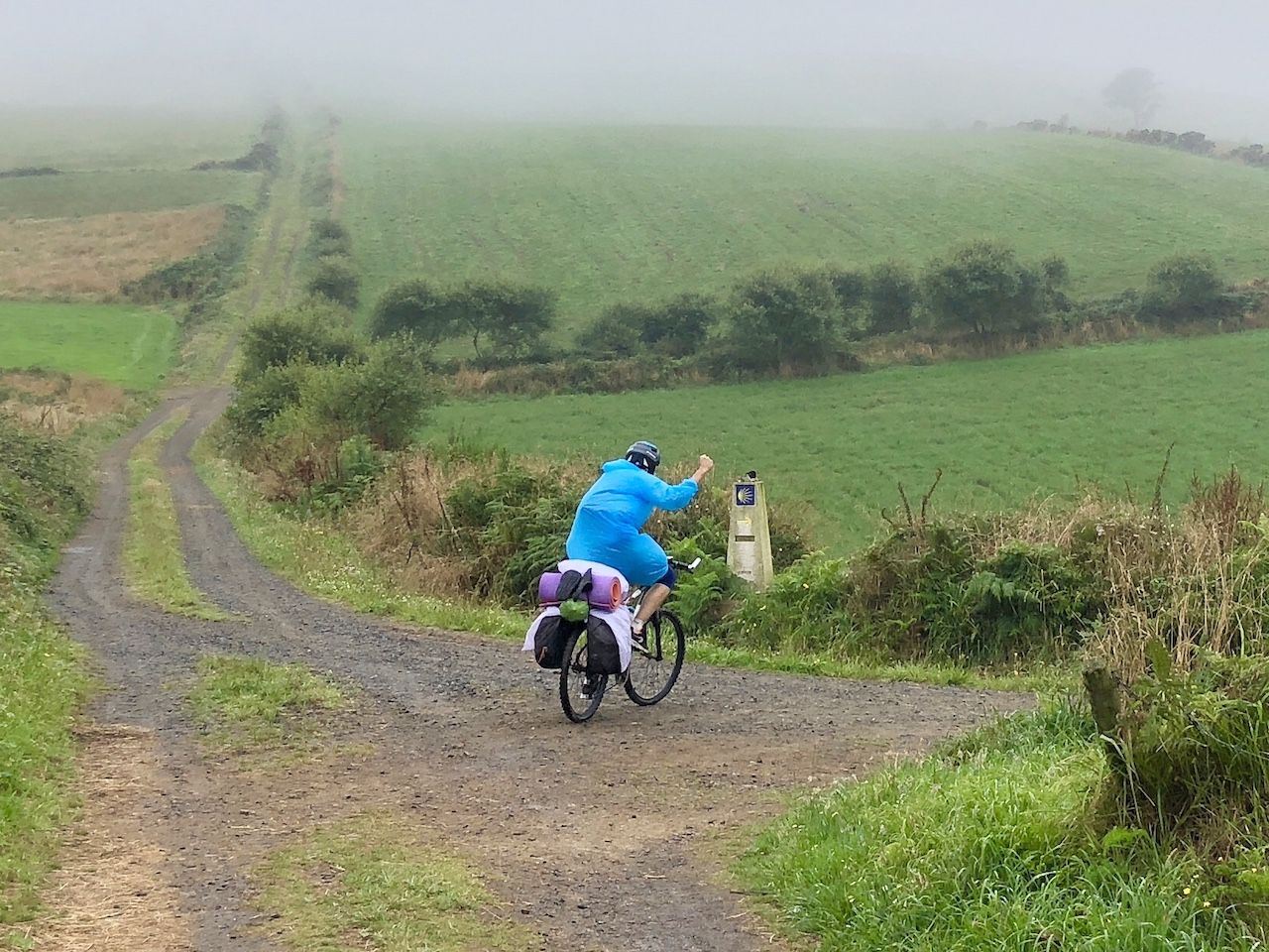 Cyclist in the rain in Galicia