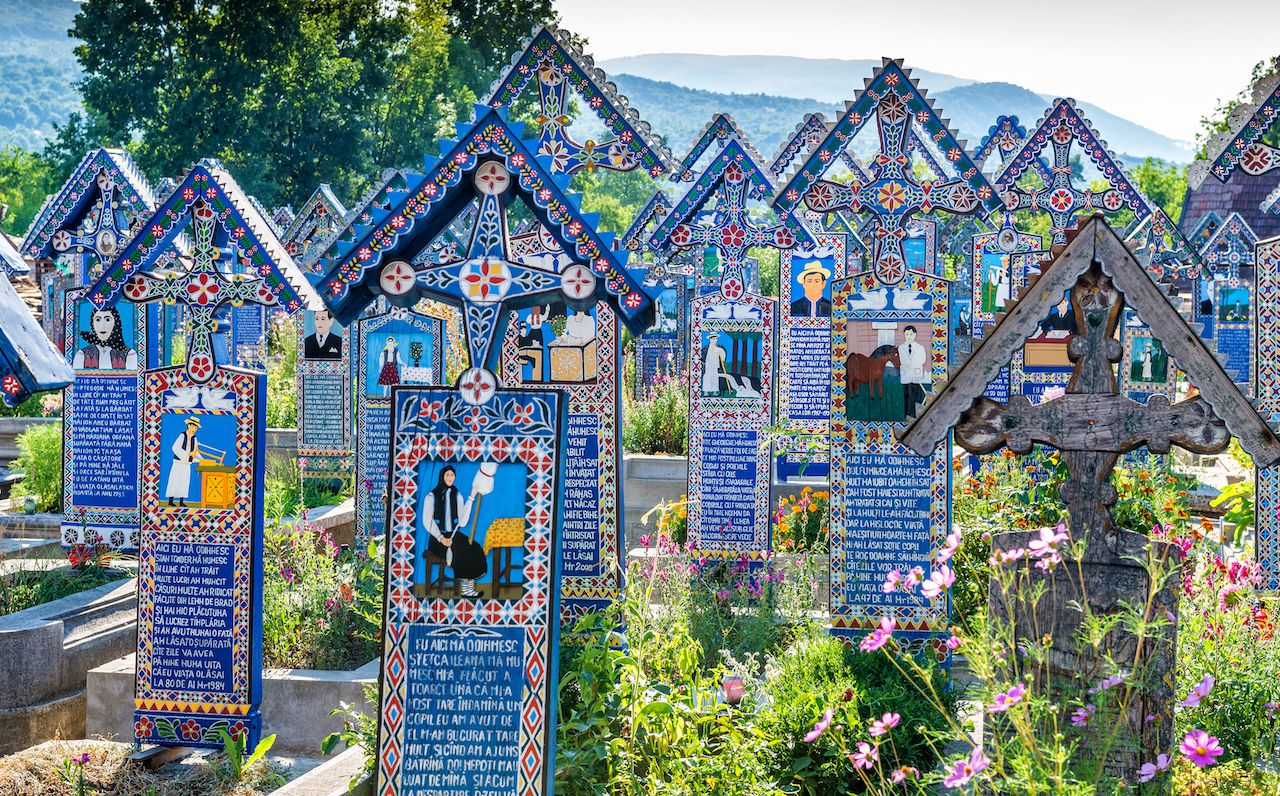 Painted wooden crosses in the famous Merry Cemetery in Maramures