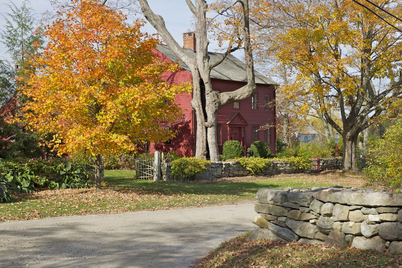 Red cottage in Connecticut countryside during foliage season