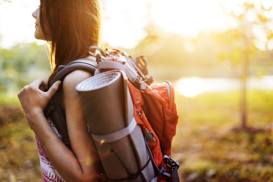 Backpacker traveler sunset