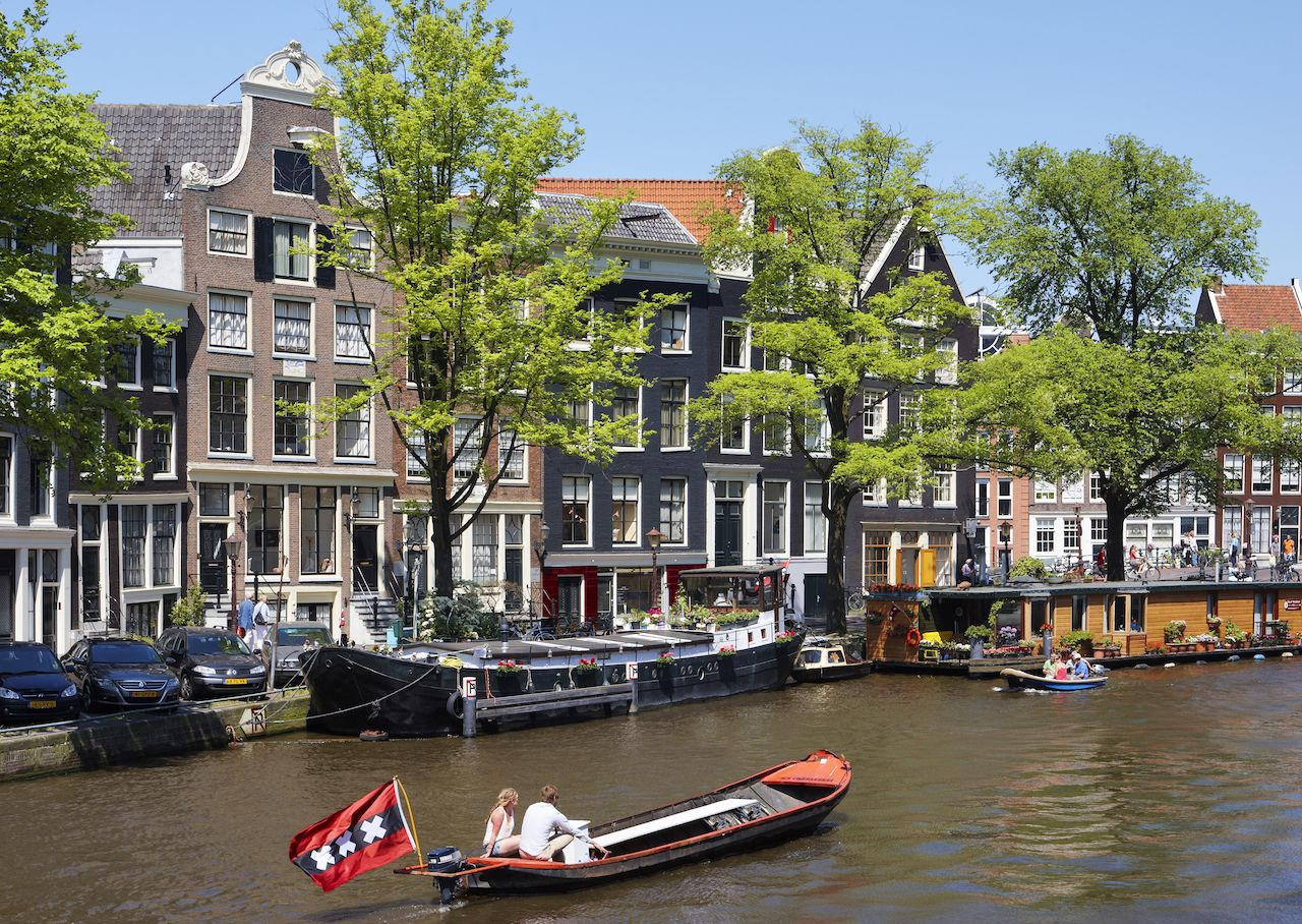 Boat floating down a canal in Amsterdam