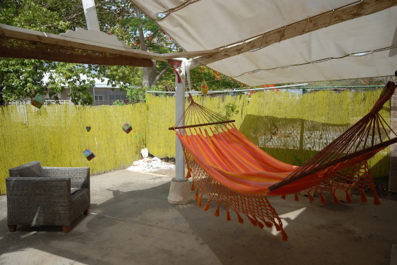 Bohemian surf apartment Airbnb in Curacao orange hammock