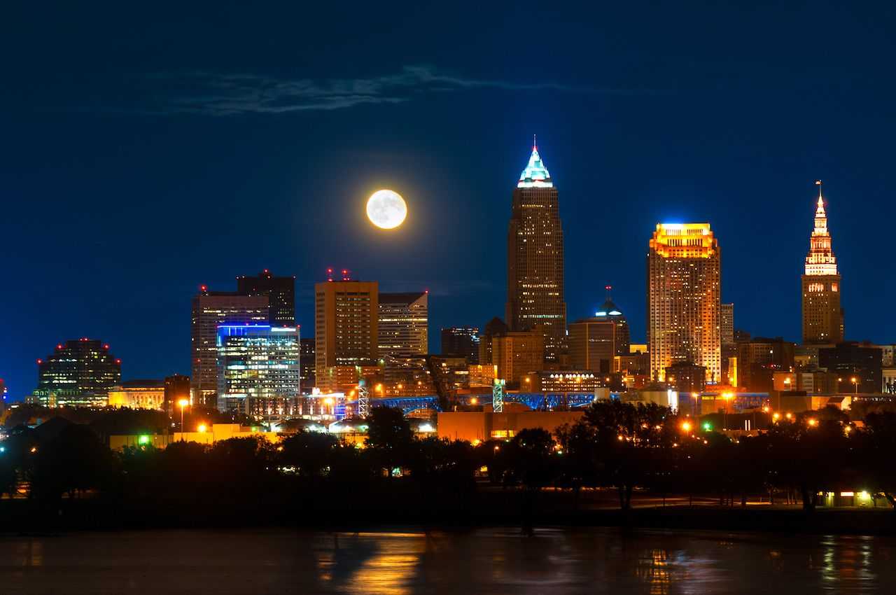 Brightly lit Cleveland, Ohio, under a just risen full moon