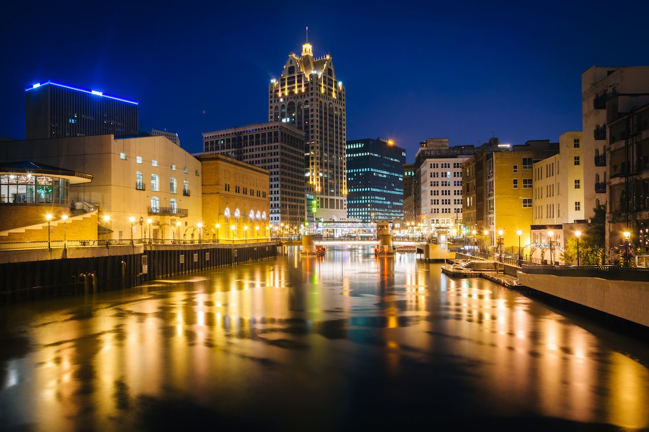 Buildings along the Milwaukee River at night in Wisconsin