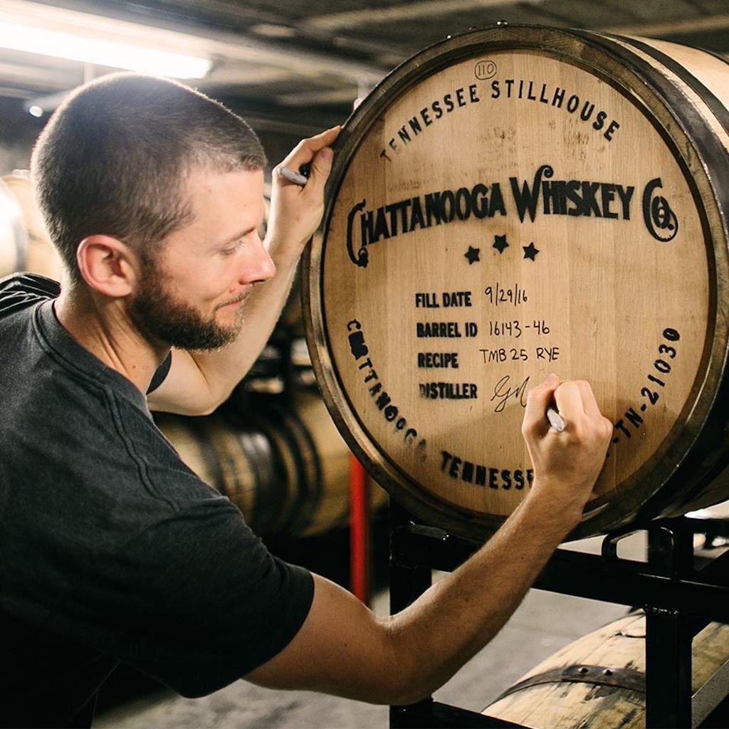 Man signing barrel at Chattanooga Whiskey in Tennessee