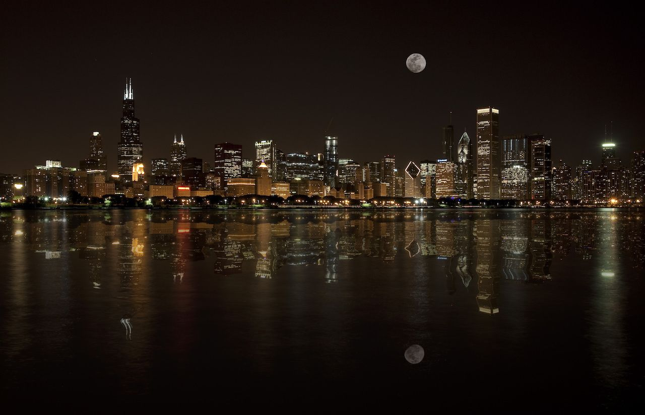 Chicago skyline with the moon rising on the horizon