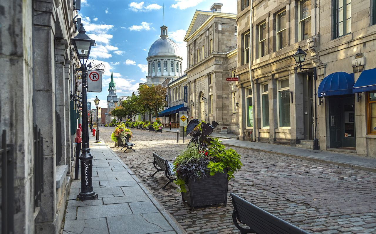 Cobbled streets in Montreal under blue skies