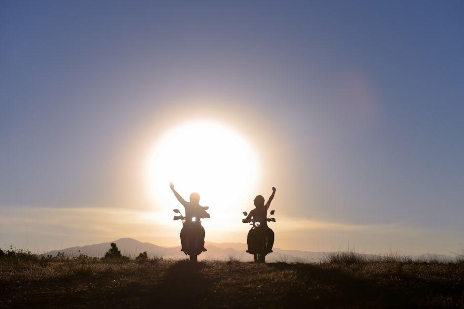 Couple riding motorbikes