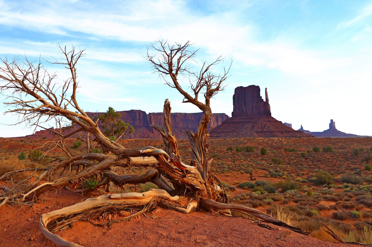 Desert landscape with rock butte in Monument Valley in Utah