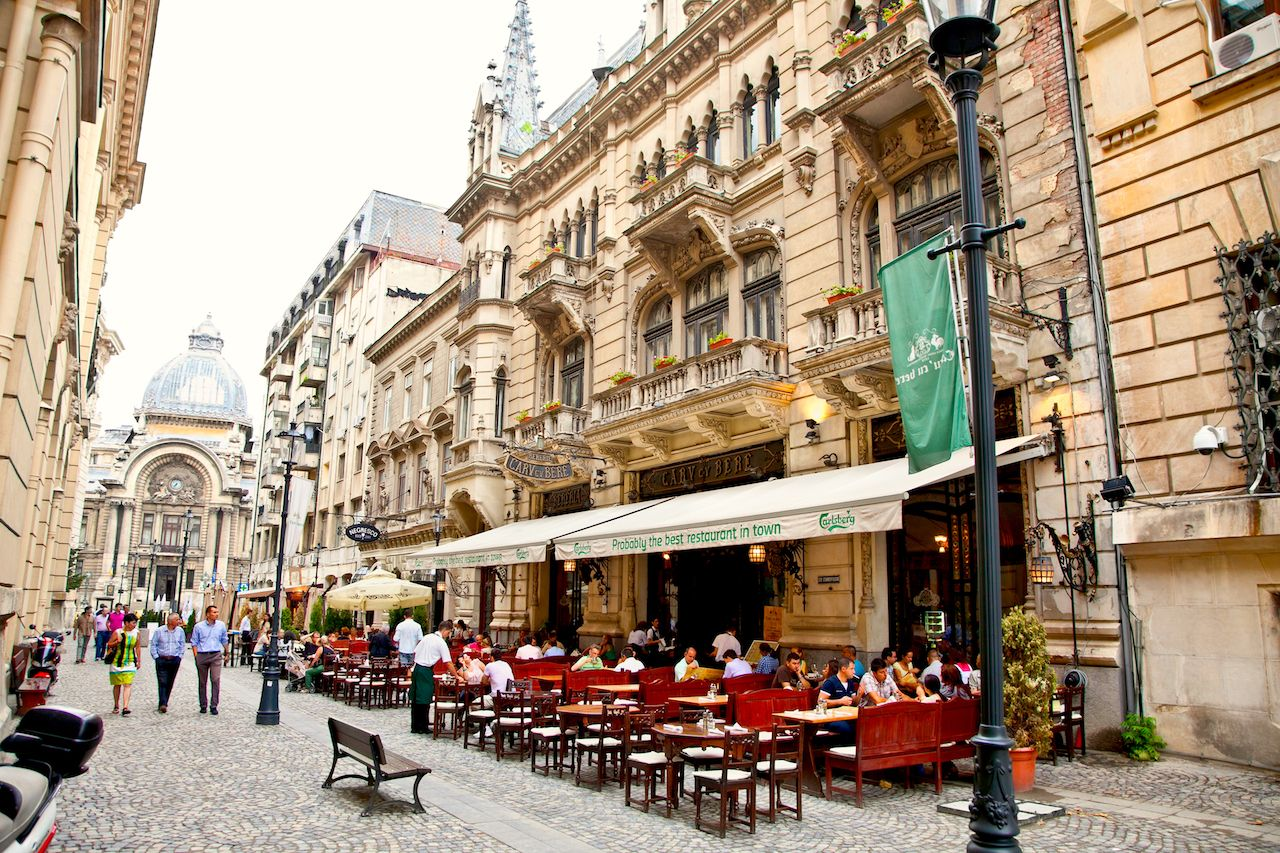 Diners outdoors in downtown Bucharest, Romania