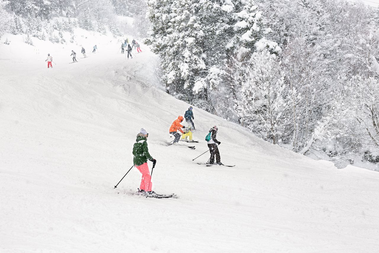 Downhill skiing during a heavy snowfall