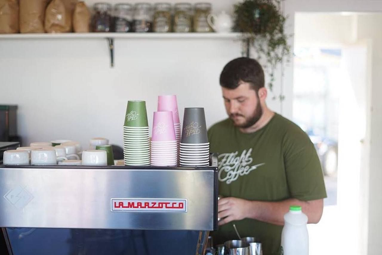 Barista behind the counter at Flight Coffee in Wellington