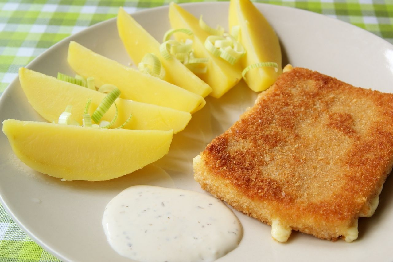 Fried cheese with potatoes, a traditional Czech meal