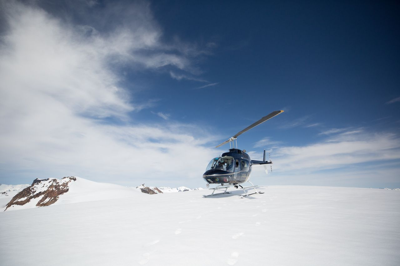 Nimmo Bay helicopter on snowy mountain face