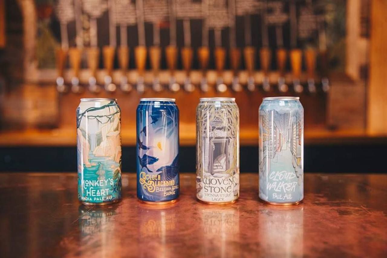 Beer cans on the bar at OddStory Brewing Company