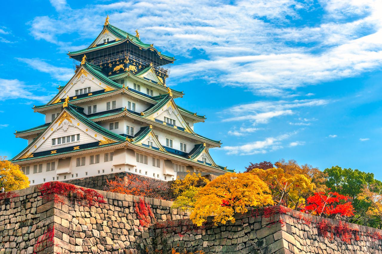 Osaka Castle in Osaka with autumn leaves Japan