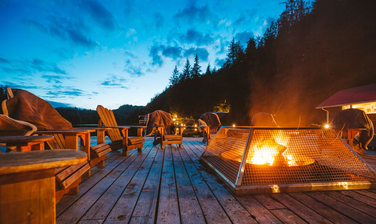 Patio seating with fire at Nimmo Bay Wilderness Resort