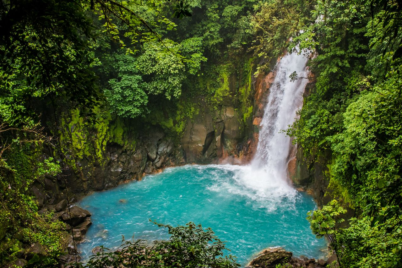 Rio Celeste waterfall in the jungle in Costa Rica