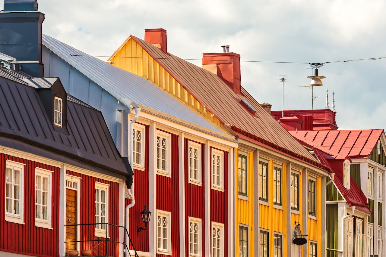 Row of ancient colorful wooden houses in the city of Karlskrona Sweden