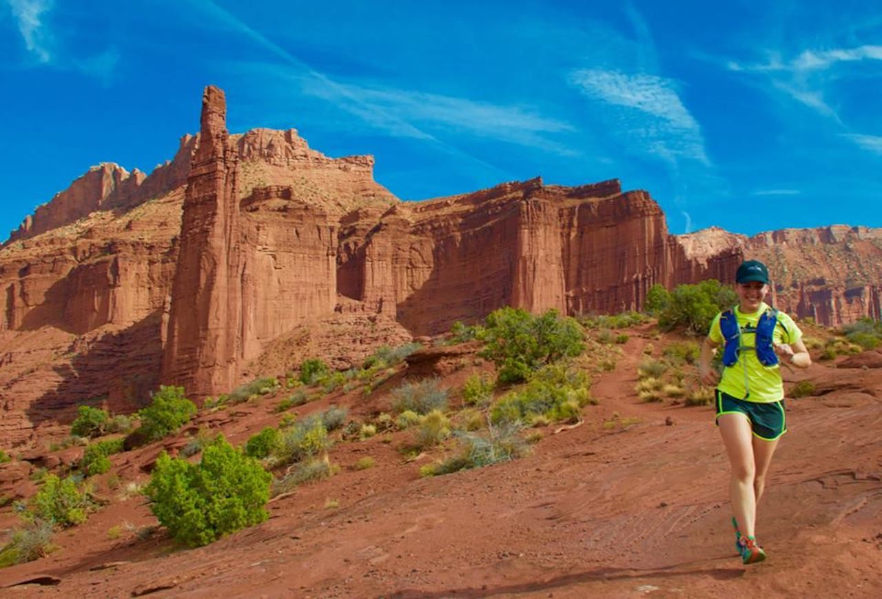 woman running through the Moab desert