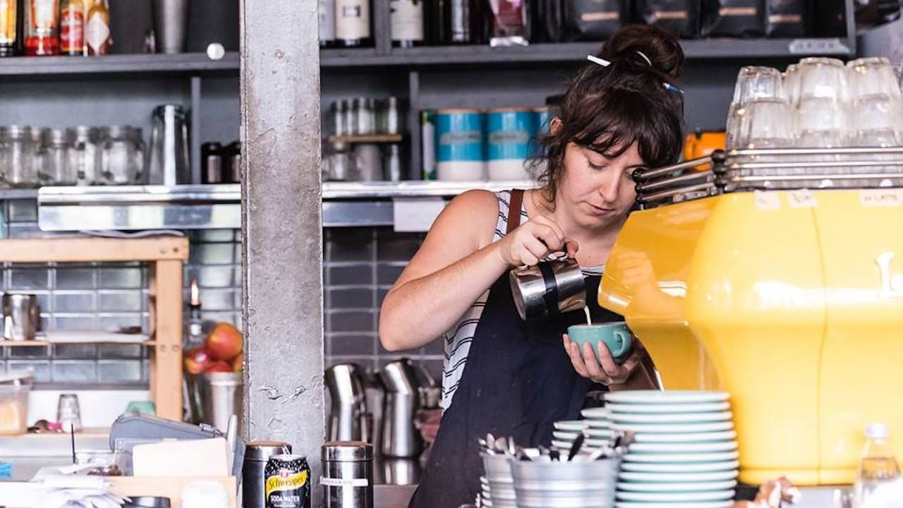 Barista pouring coffee at the St Ali coffee shop in Melbourne