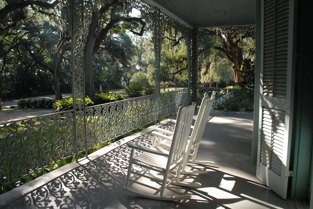 Empty front porch of The Myrtles Plantation in Louisana